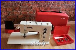 Bernina Record 830 sewing machine with accessories and carry case