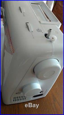 New Singer sewing machine with foot pedal and carry case