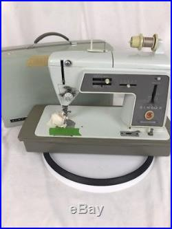 SINGER Touch & Sew Model 600 Sewing Machine withPedal & Carrying Case