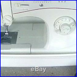 Singer Sewing Machine 5160 C Model with carrying case works good
