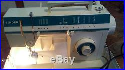 Singer Sewing Machine 5817 C with Carry Case. And foot pedal in great condition