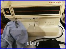 Singer futura 2001 Electric Sewing Machine in carry case with manual